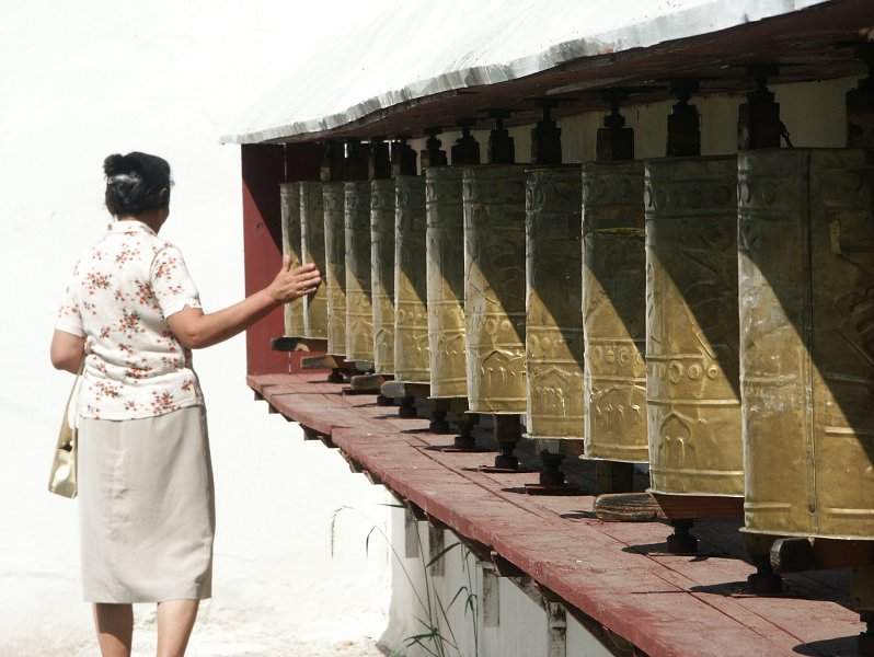 buddhist prayer cylinders at bakula monastery.